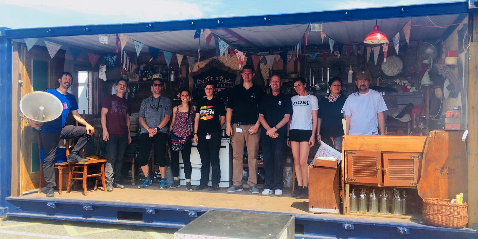 Photo of the Teatro Container team with their kitchen in a shipping container when they arrived at Tilbury.