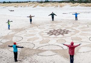 Mandala on beach by Therese Muskus