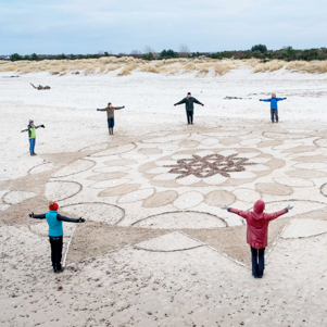 Mandala on beach by Therese Muskus