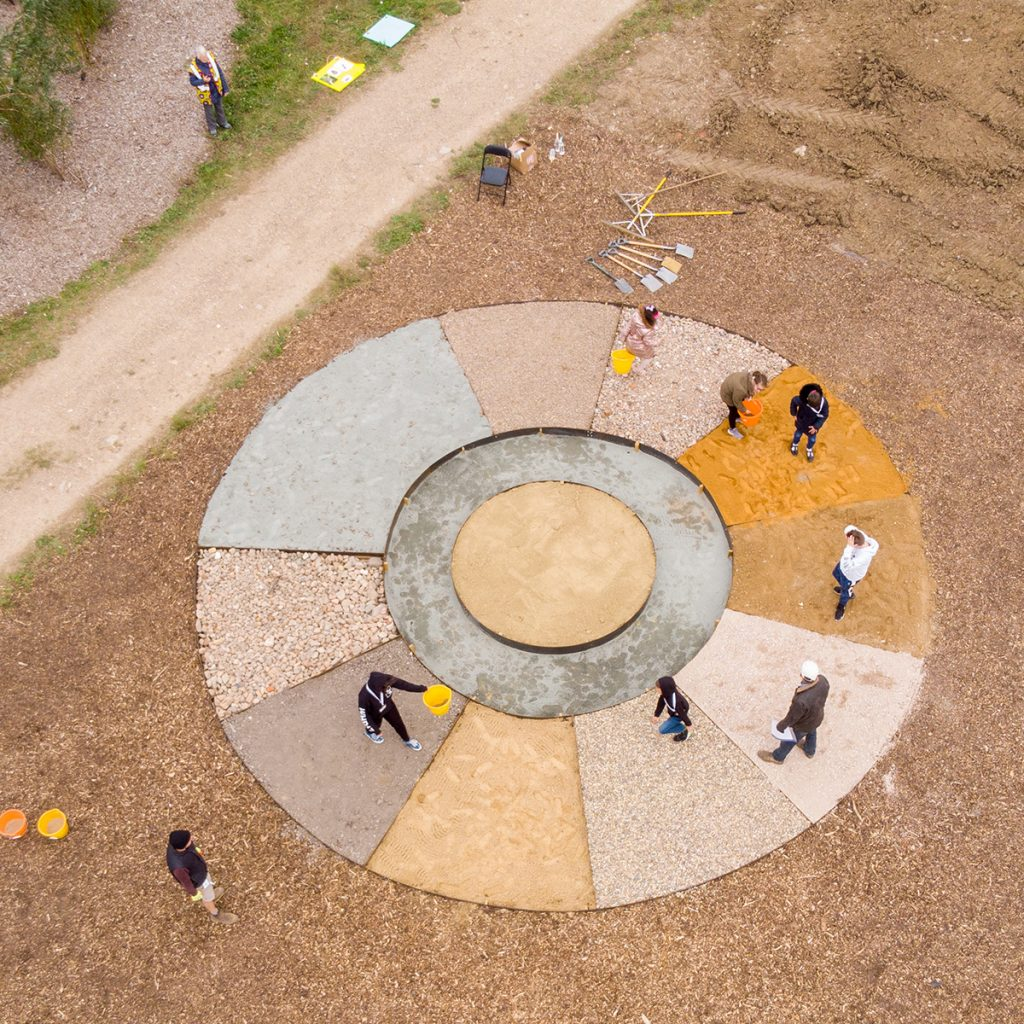 Large circular mandala made from different coloured earth