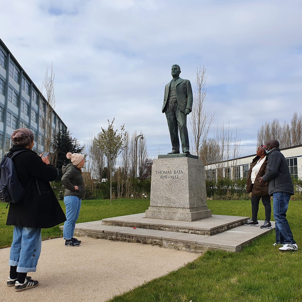 People view statue of Bata factory founder